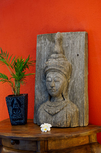 Buddha on old Teak Wood